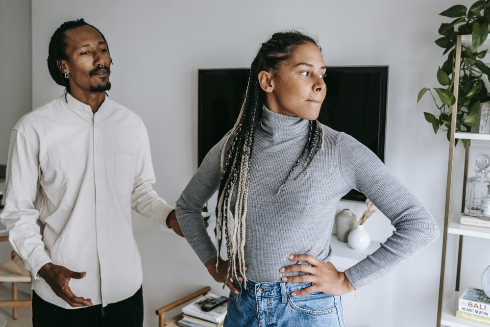 Black man apologizing while talking with girlfriend