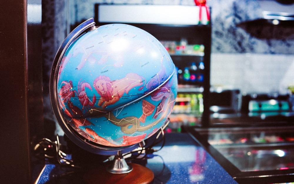 globe desk on table