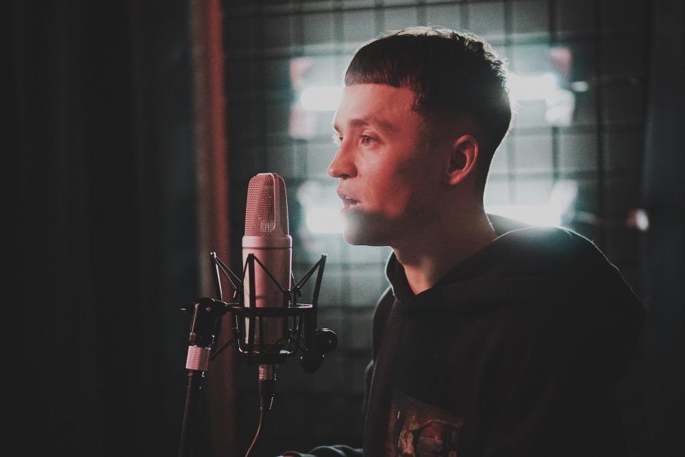 man singing inside room