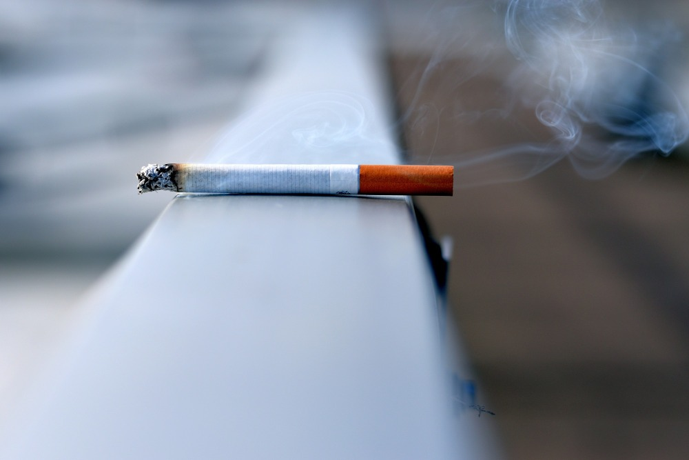 white cigarette stick on white wall