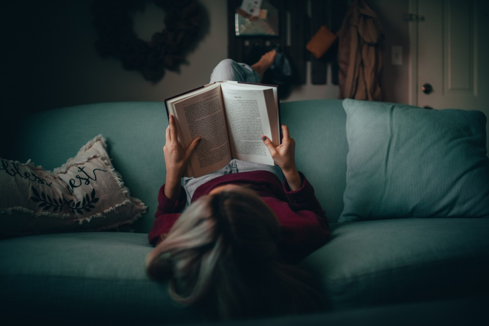 woman in red shirt reading book